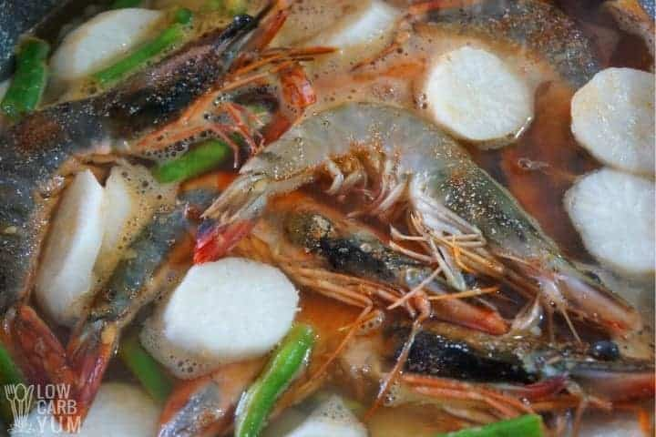 adding shrimp to sinigang na hipon