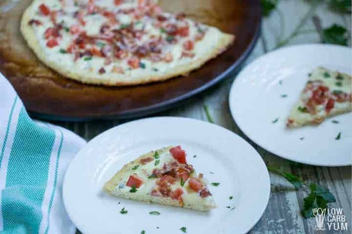 slices of bacon ranch chicken crust pizza on plates