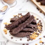 chocolate biscotti on plate with chocolate chips and nuts