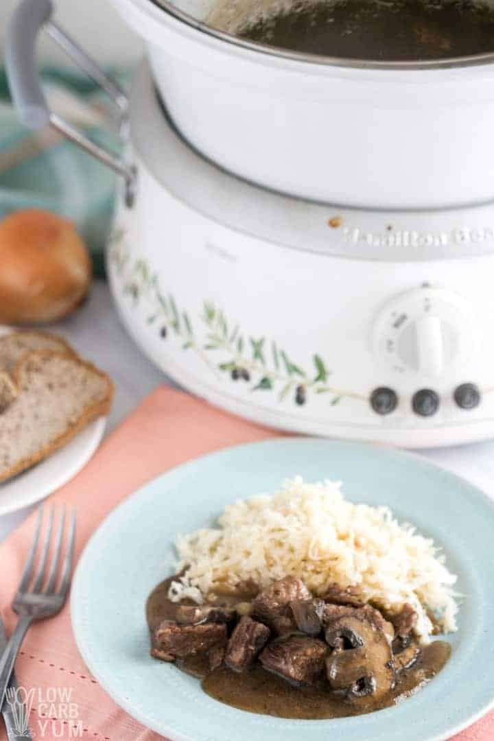 plate of steak tips with crock pot