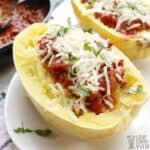 Low Carb Yum's spaghetti squash halves with marinara and cheese