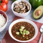 close up of vegan crockpot chili and ingredients