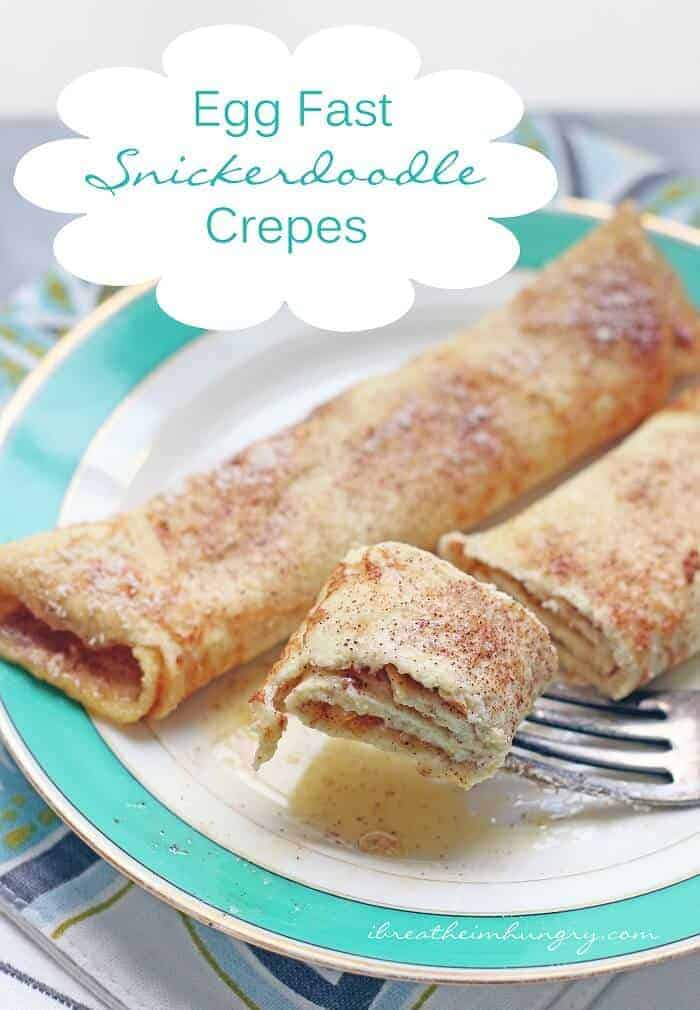 keto Snickerdoodle Crepes on plate with fork holding bite of crepes