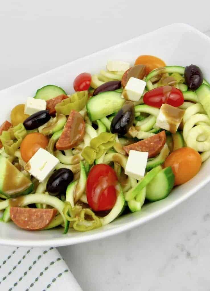 low carb zucchini noodle salad with cucumbers, tomatoes, summer sausage ad black olives
