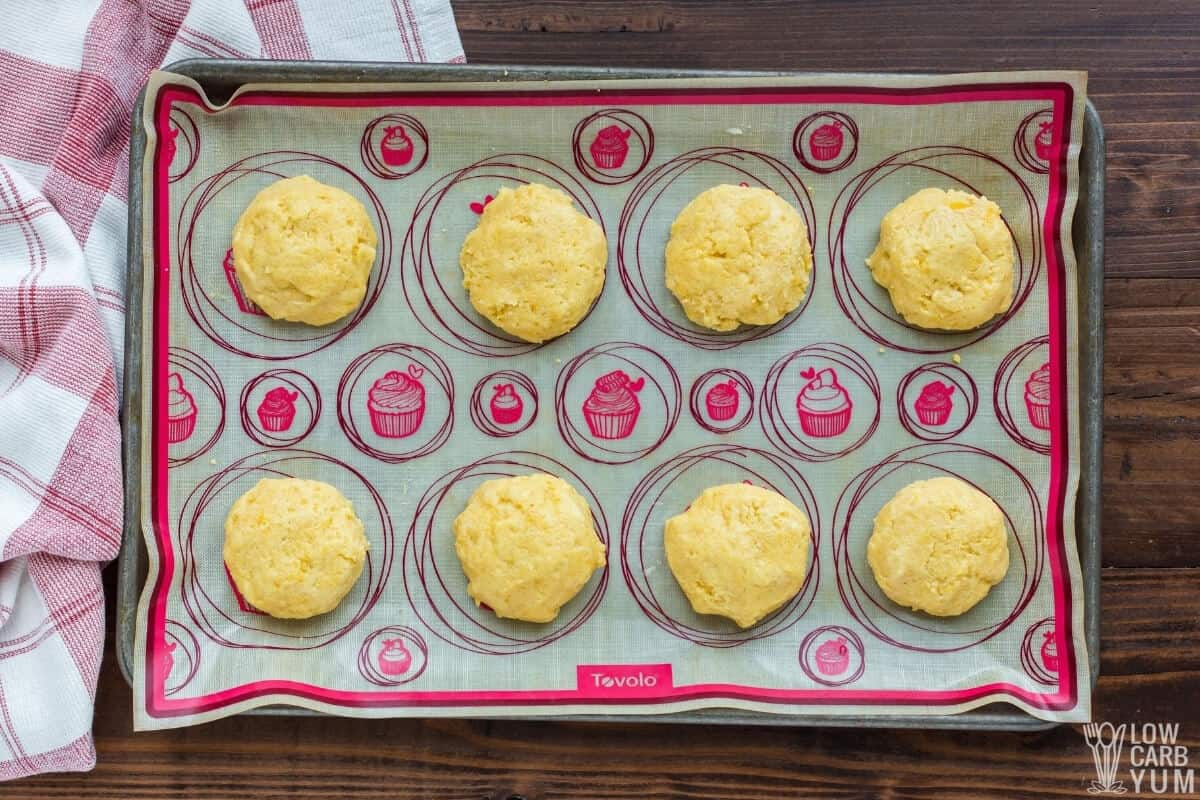 almond flour biscuit dough mounds on lined baking sheet