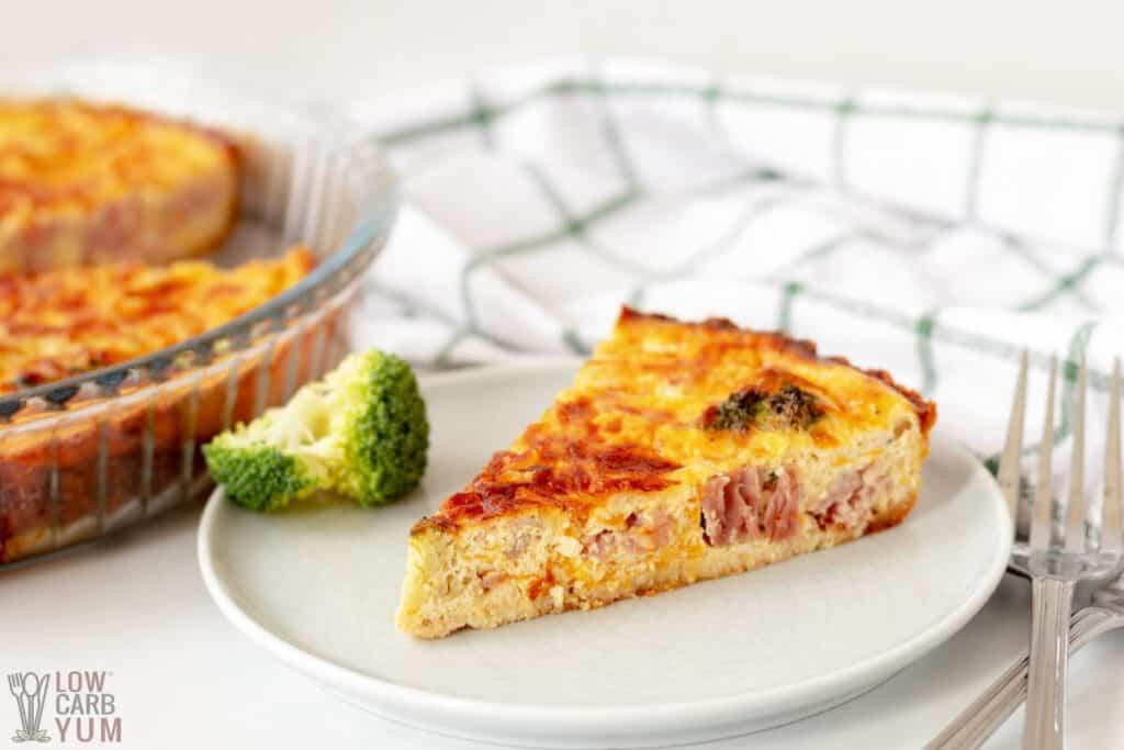 slice of broccoli and ham quiche on small plate