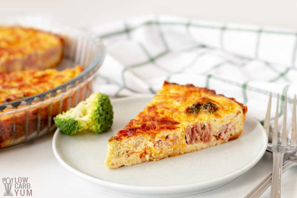 slice of broccoli and ham quiche on small plate