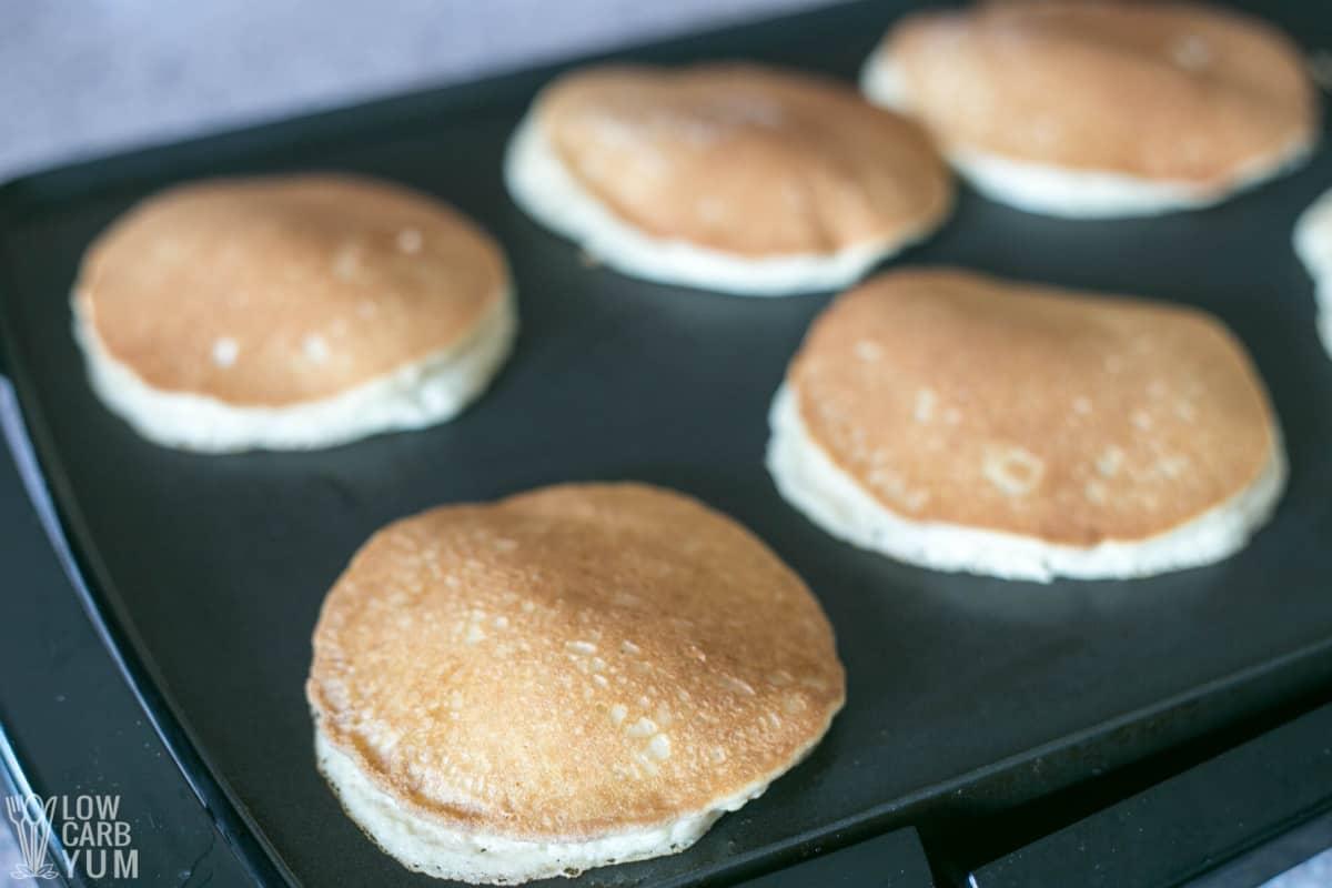 keto almond flour pancakes on griddle