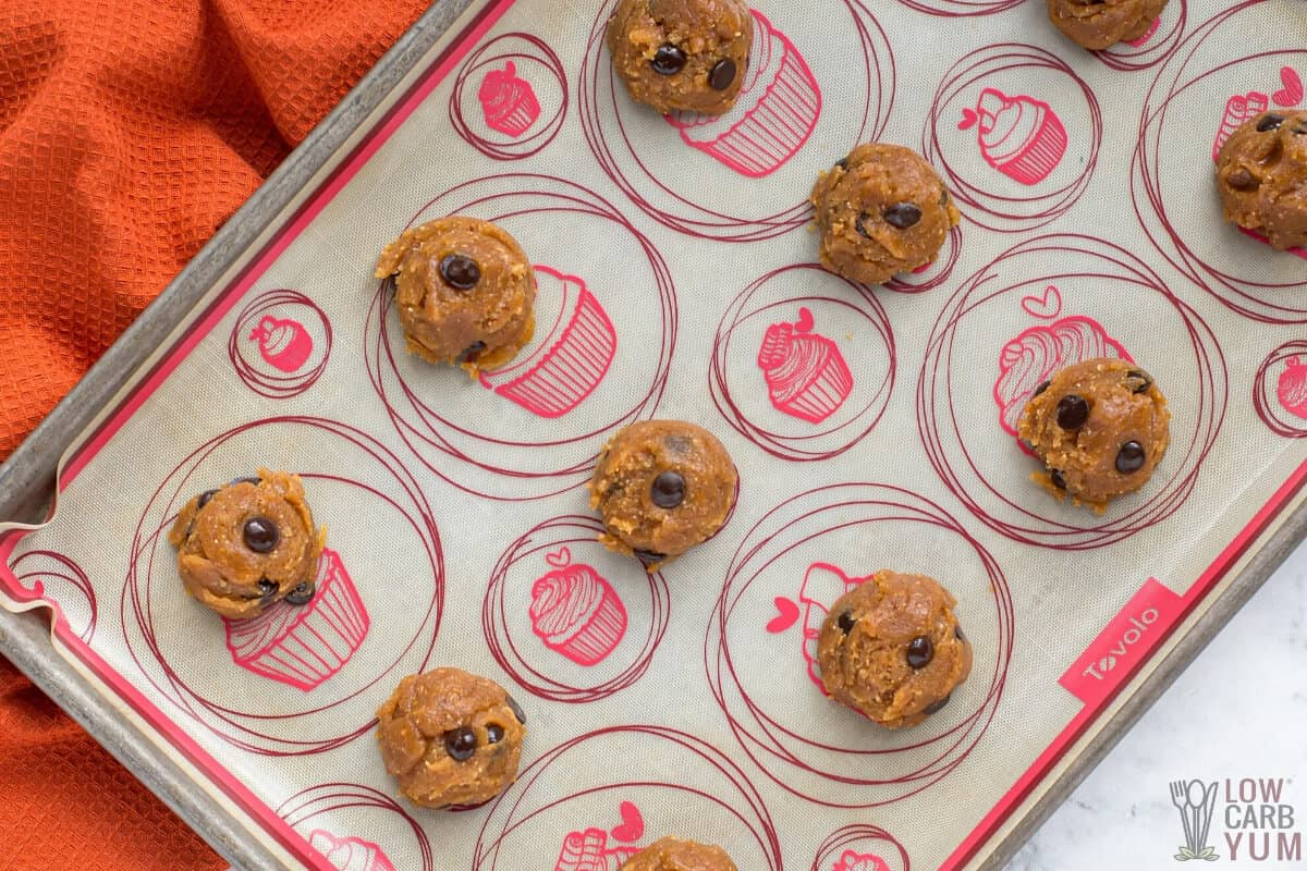 cookie dough balls on lined sheet