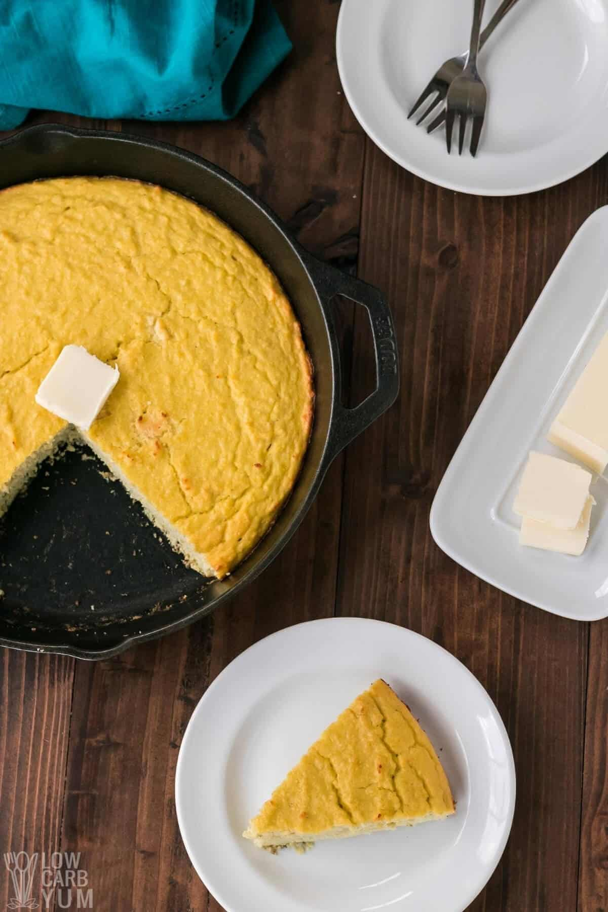 slice of cornbread on plate with butter