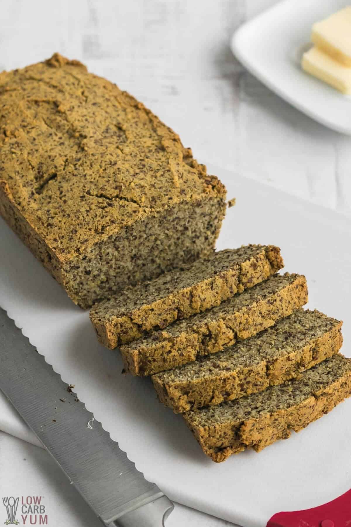sliced keto flax meal bread on cutting board