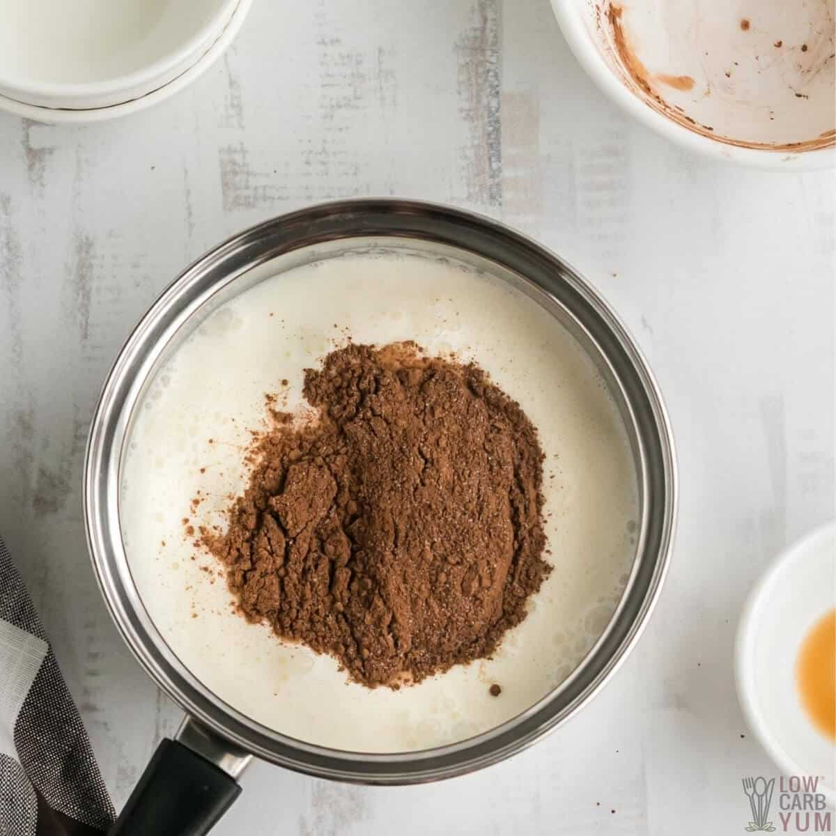 sweetener and cocoa added to water and cream in pot