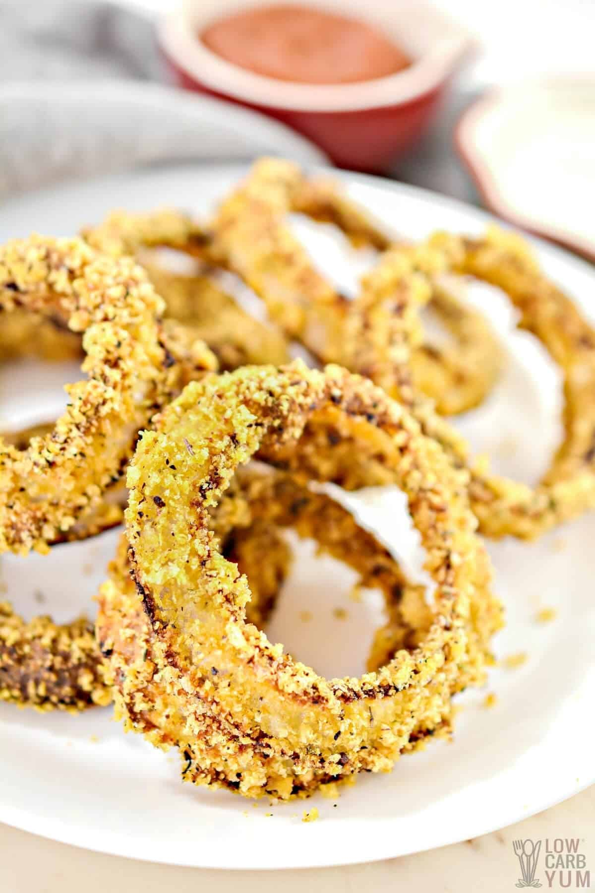 baked keto onion rings served with low carb ketchup