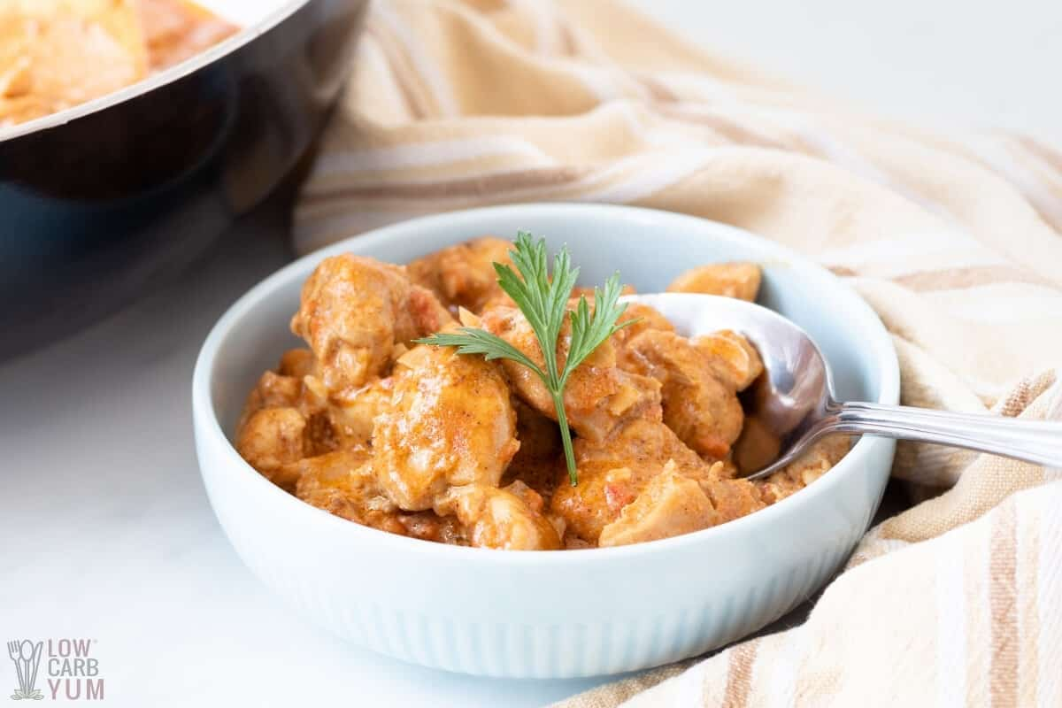 butter chicken in white bowl