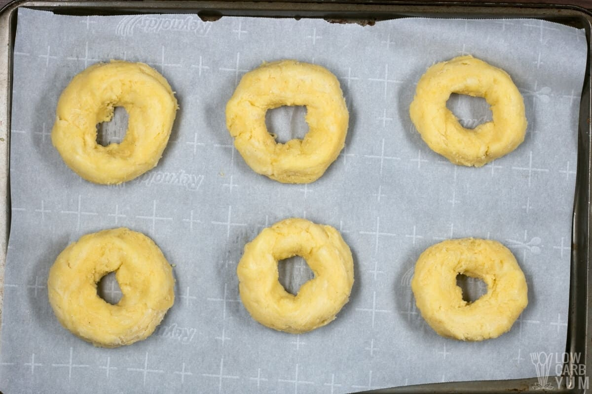 coconut flour dough in bagel shapes on lined pan