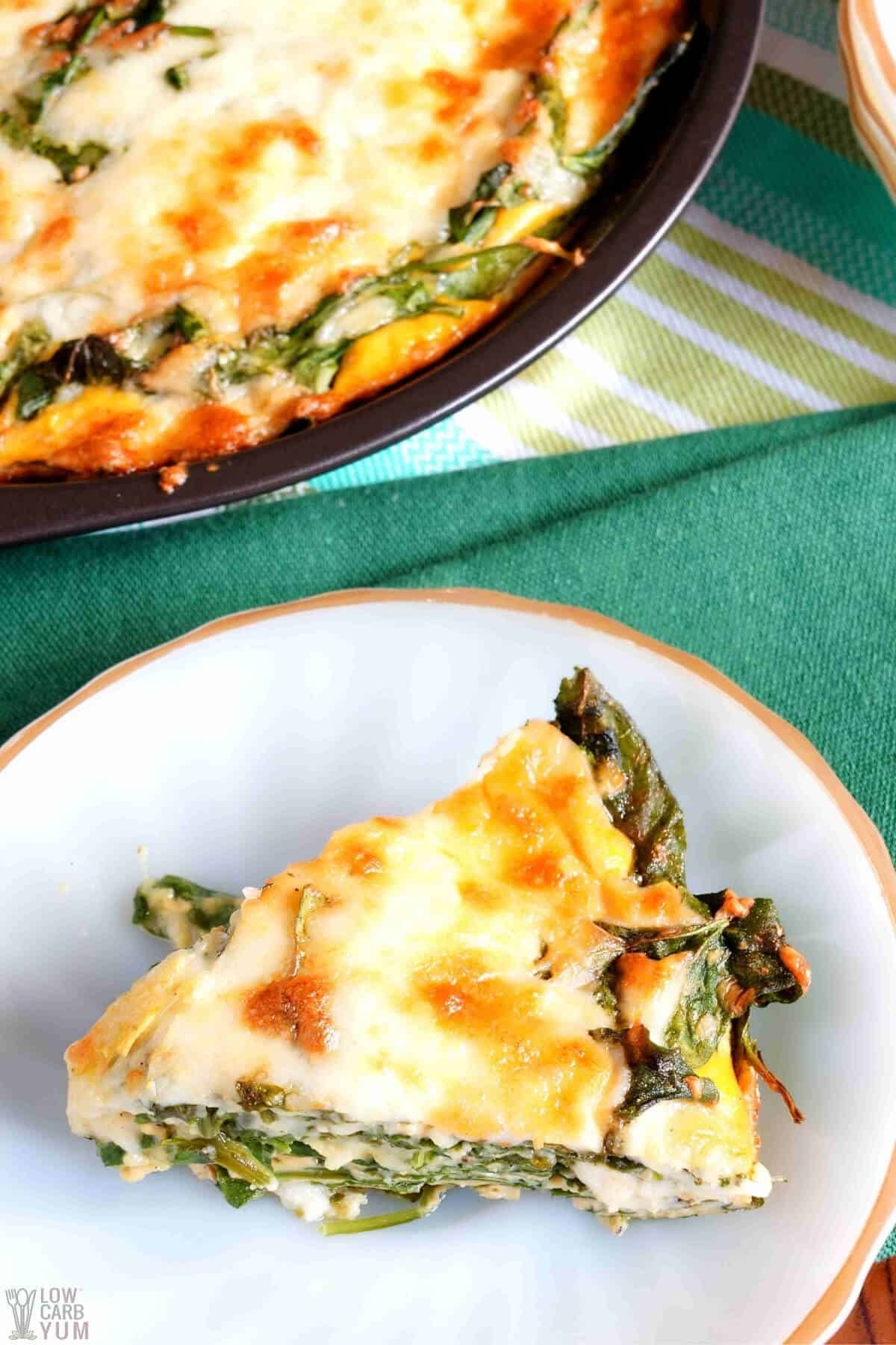 keto crustless spinach cheese pie slice with pan in back