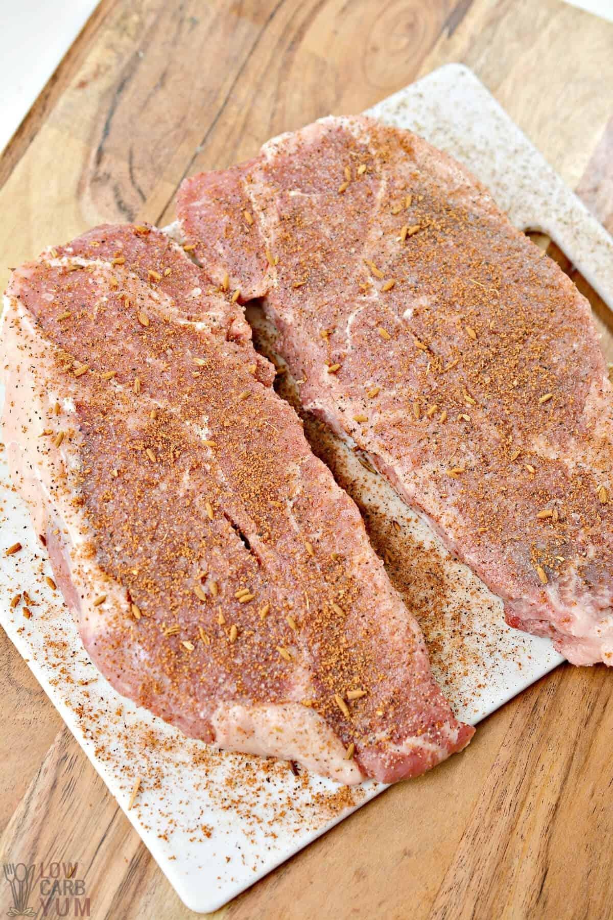seasoned steaks on board