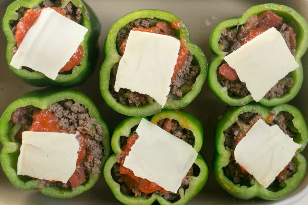 stuffing peppers and topping with cheese