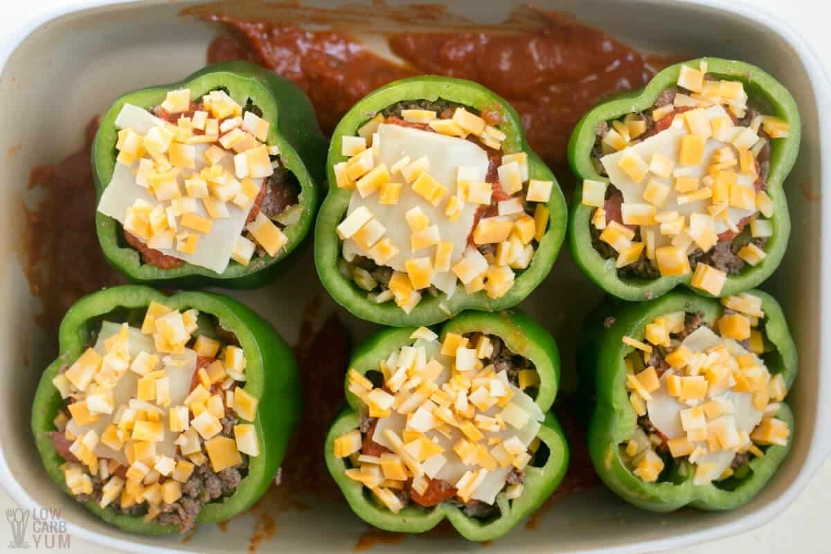 stuffed peppers with sauce in pan
