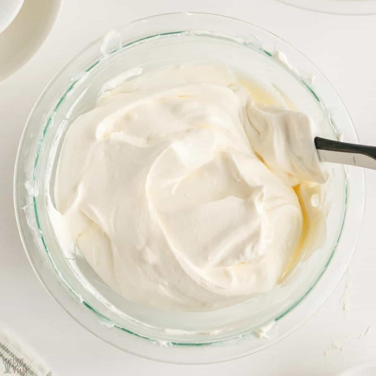 folding in whipped cream for filling