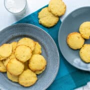 coconut flour cookies on plates with glass of milk