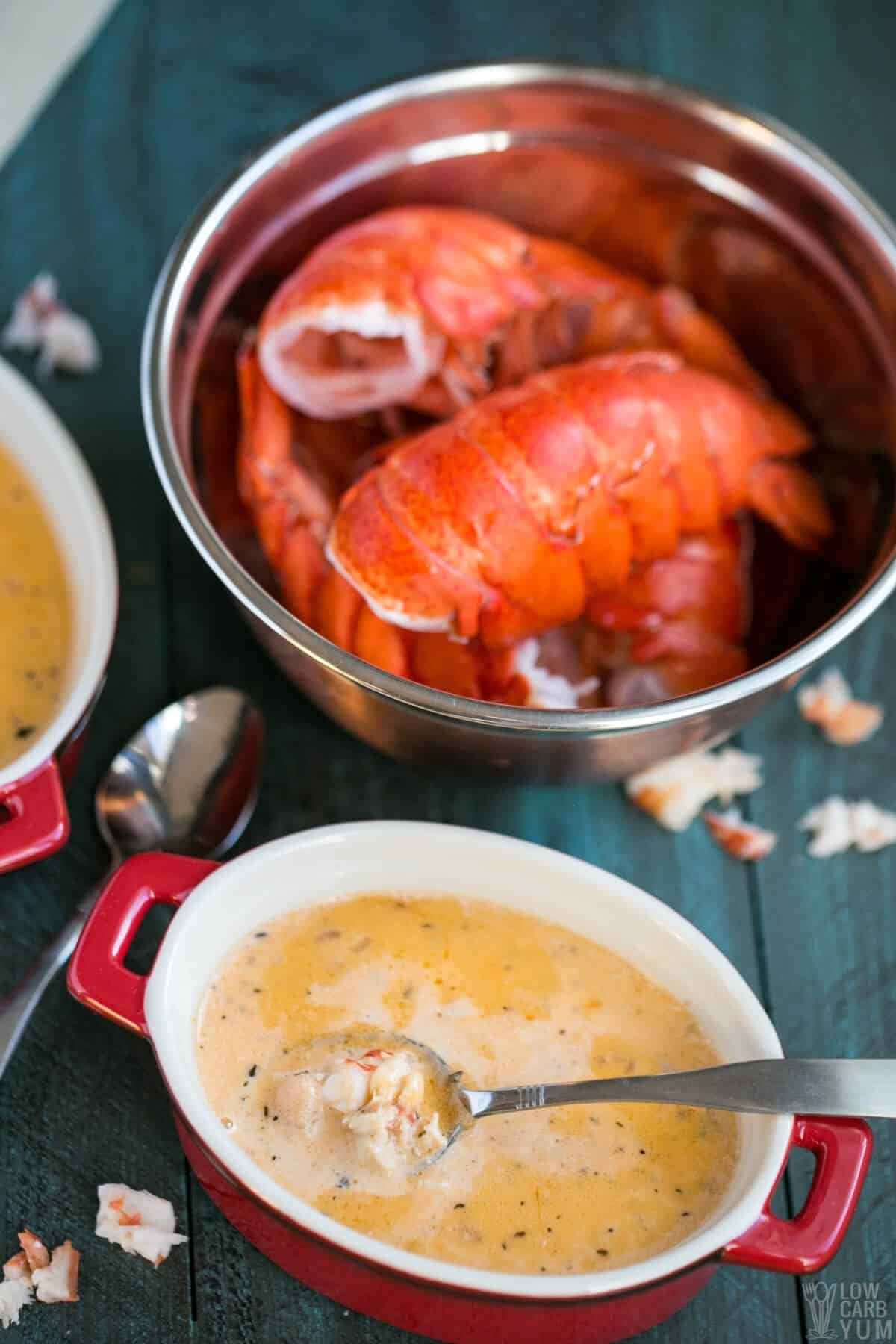 keto lobster bisque in personal crock with lobster meat on spoon