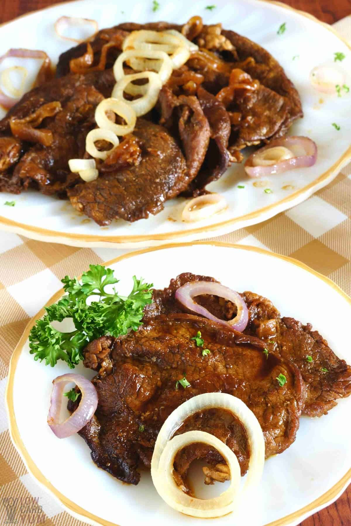 filipino bistek on plate and platter topped with caramelized red onions