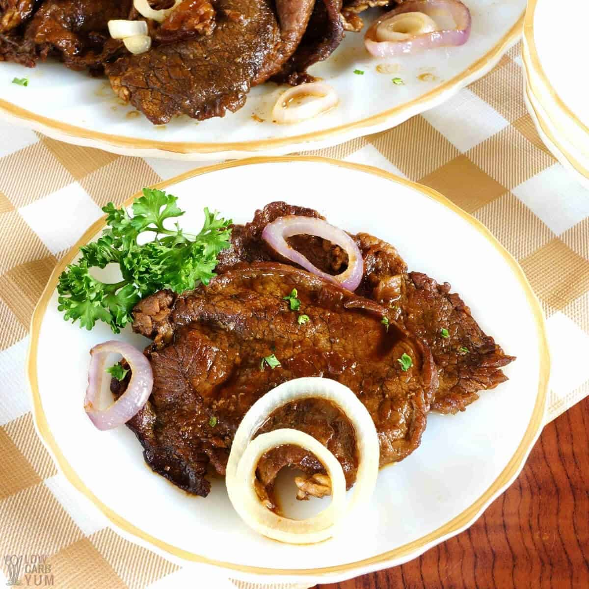 filipino beef steak bistek recipe on plates