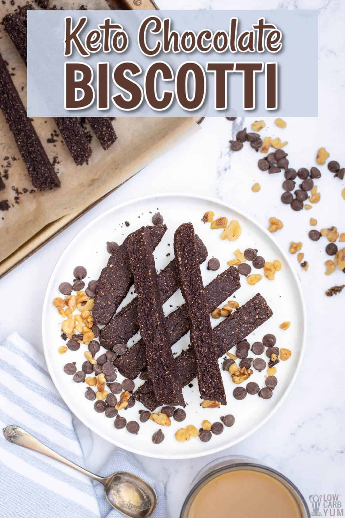 gluten-free chocolate keto biscotti with nuts and chips on white plate pinterest image