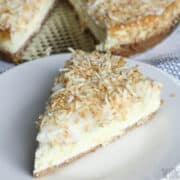 coconut cream cheesecake slice on white plate