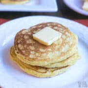 small stack of coconut flour pancakes topped with butter