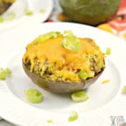baked chicken stuffed avocado on white plate