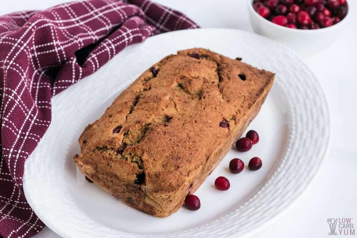 loaf of keto cranberry bread on platter