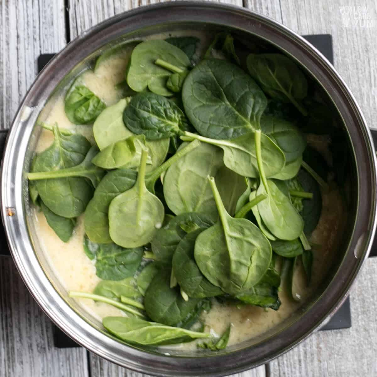 adding spinach to soup base