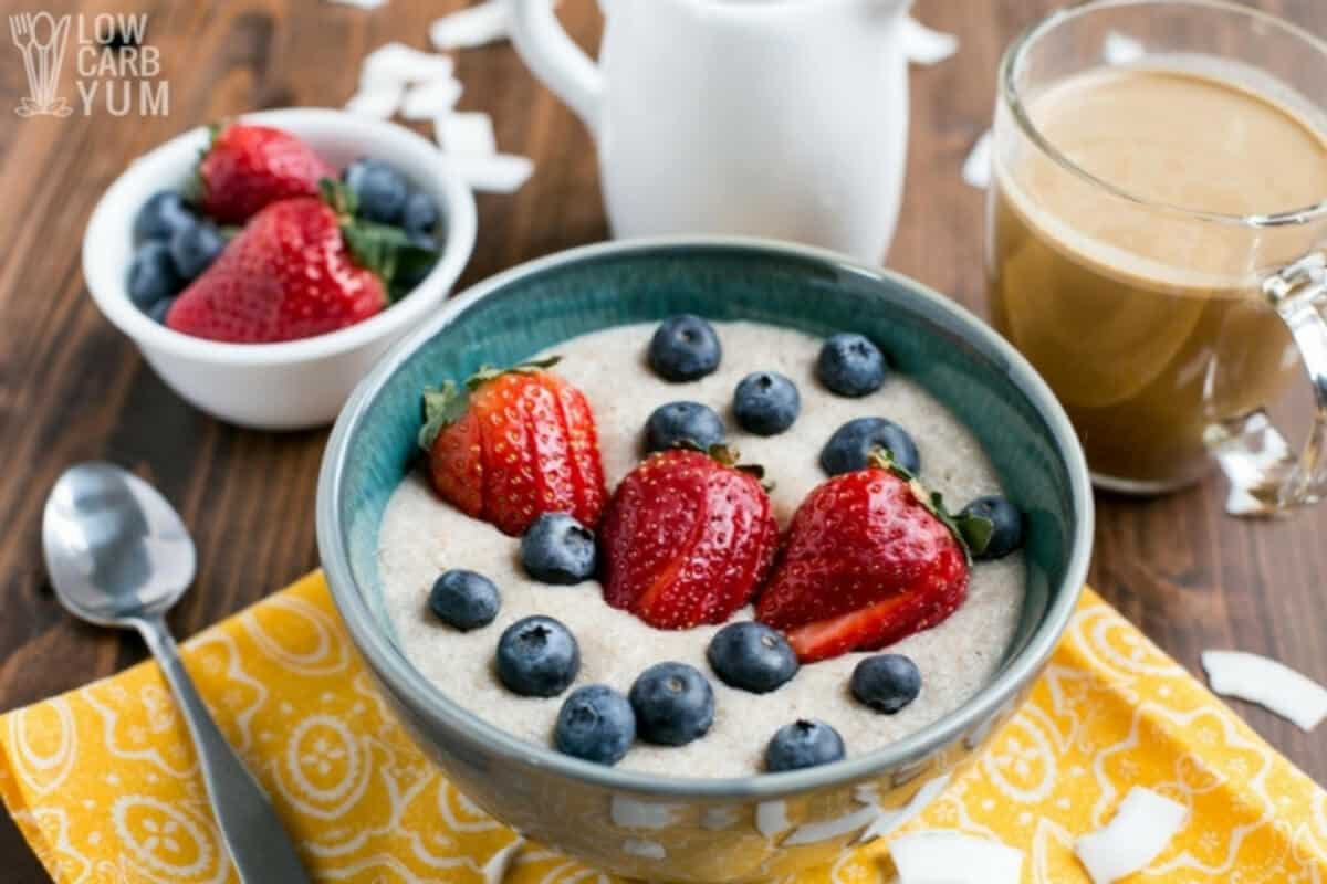 coconut flour porridge topped with berries in bowl