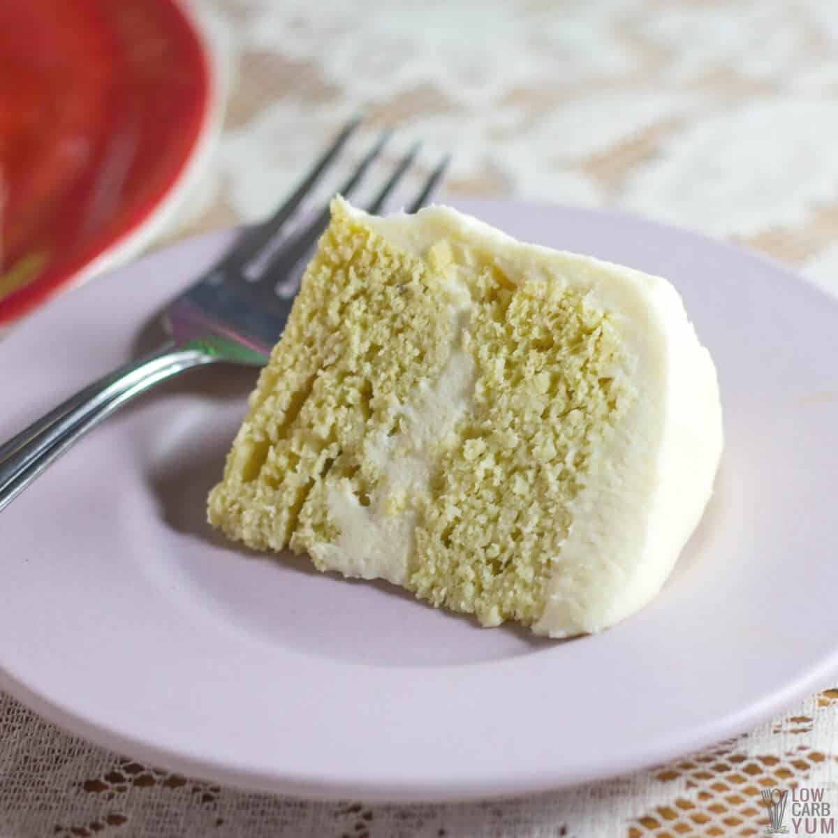 slice of keto birthday cake on lavender plate