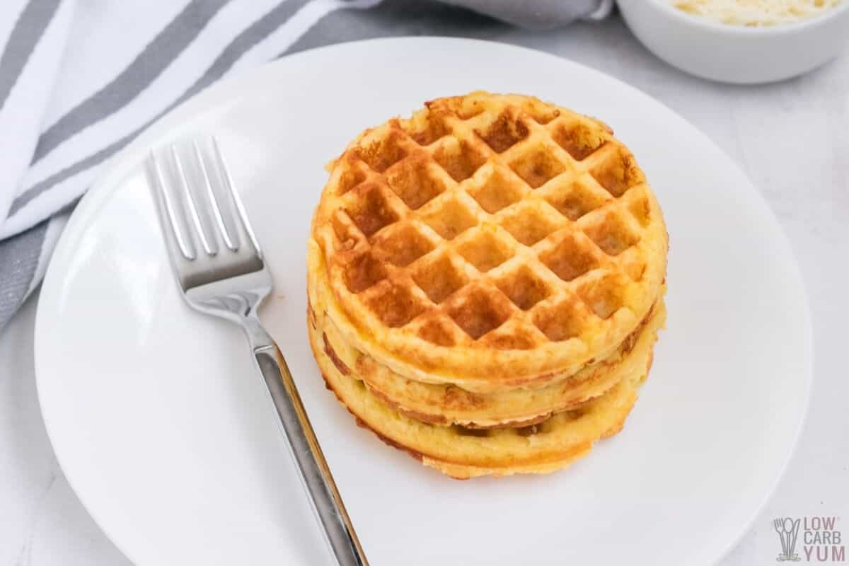 stack of chaffles on white plate with fork