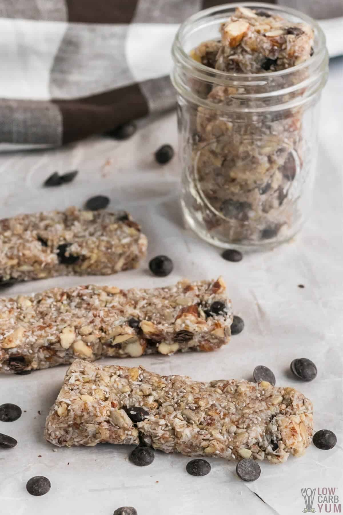 keto friendly granola bars on parchment paper and in mason jar