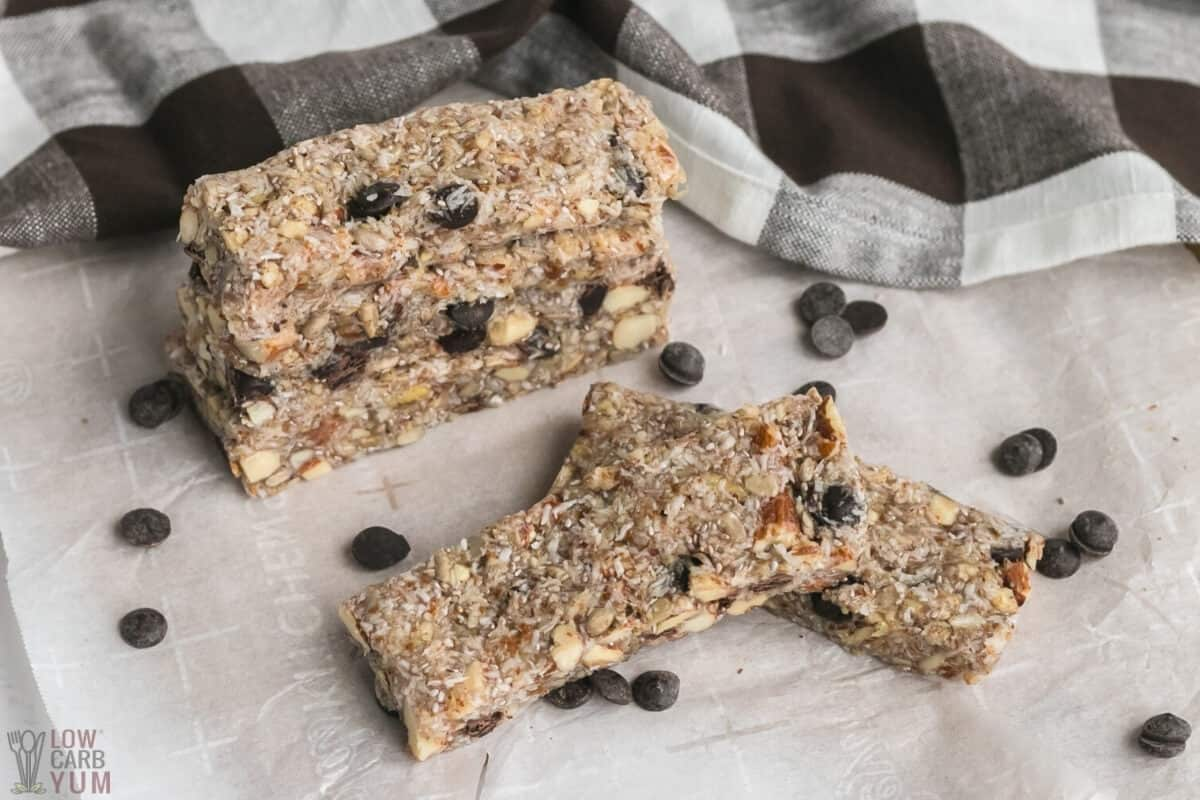 keto granola bars stacked on parchment paper