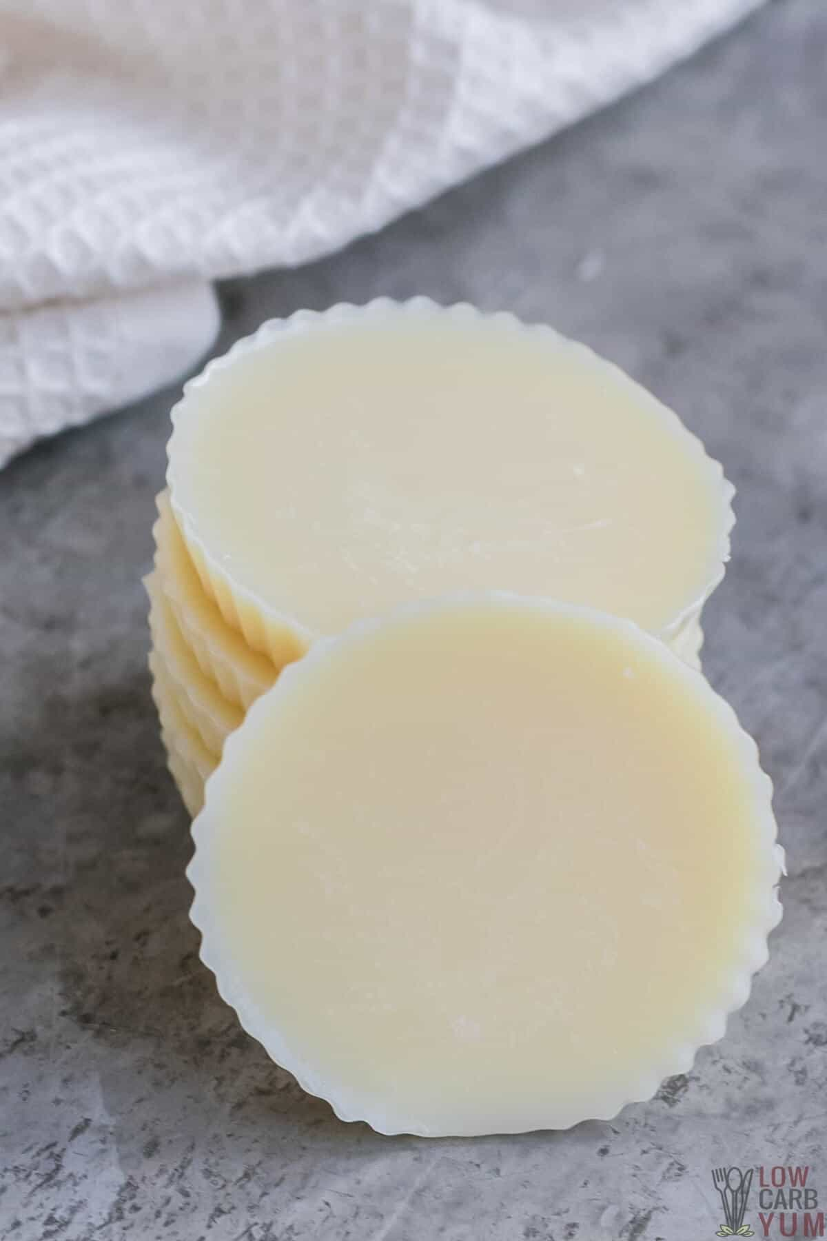keto white chocolate fat bombs stacked up with one in front