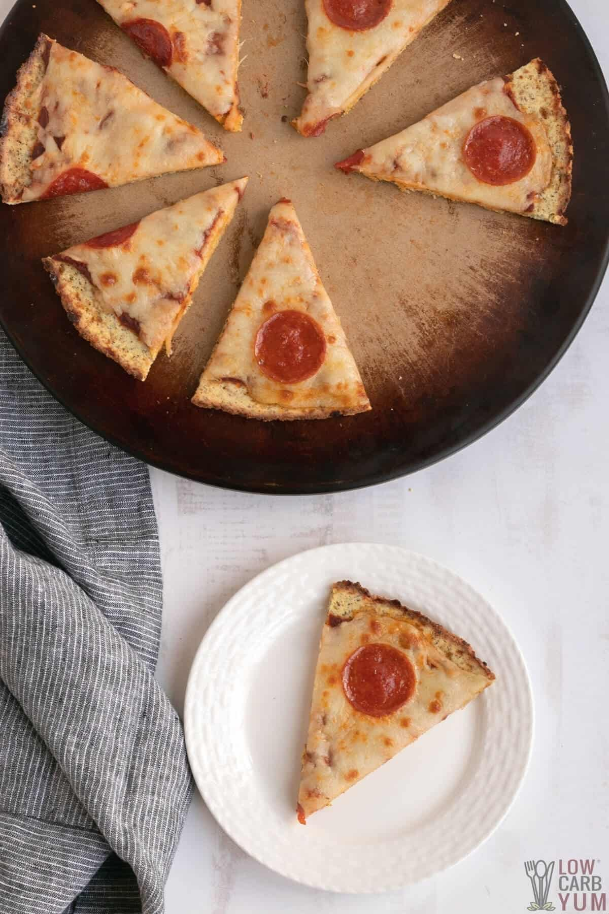 overhead of sliced pizza with coconut flour crust