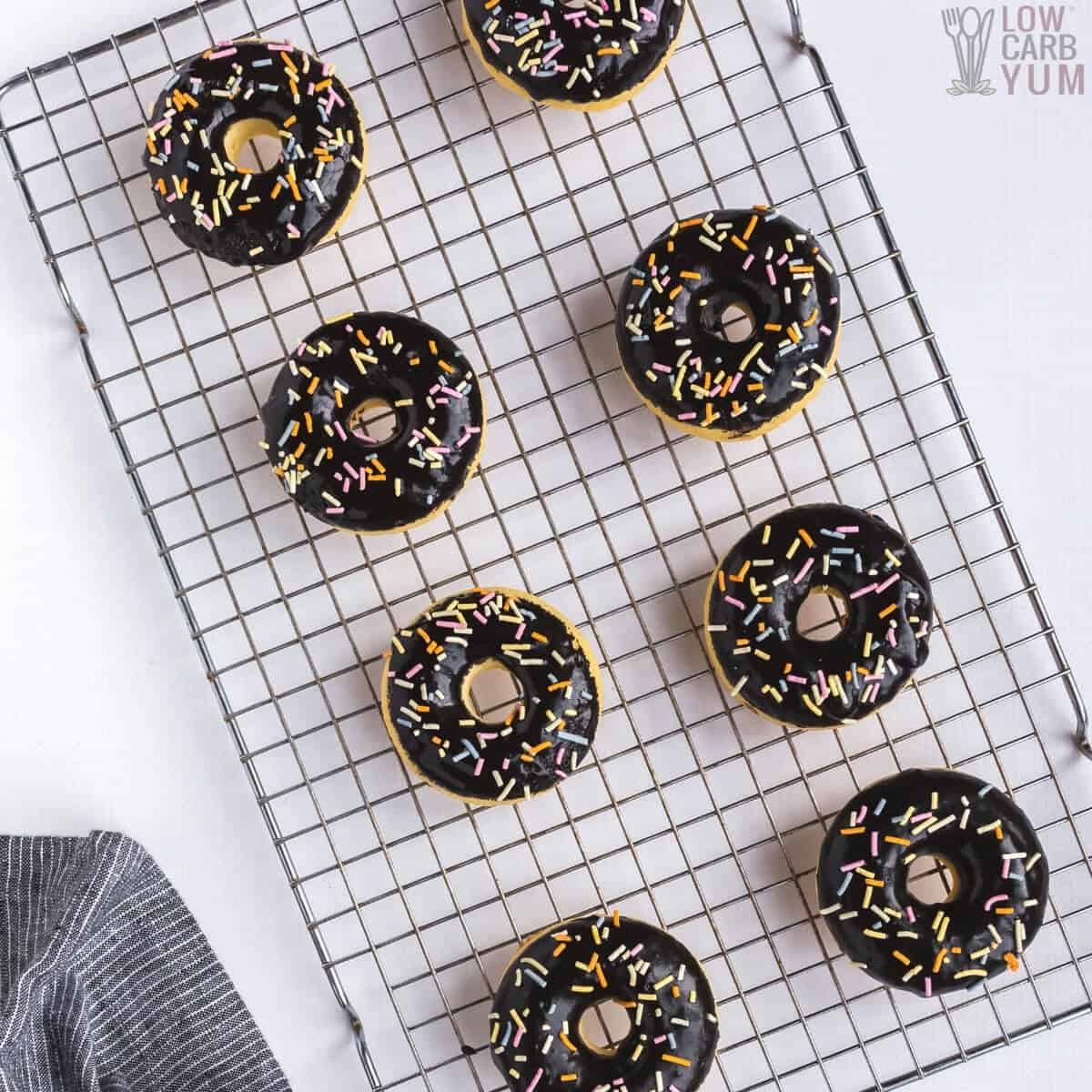 overhead of glazed donuts on cooling rack
