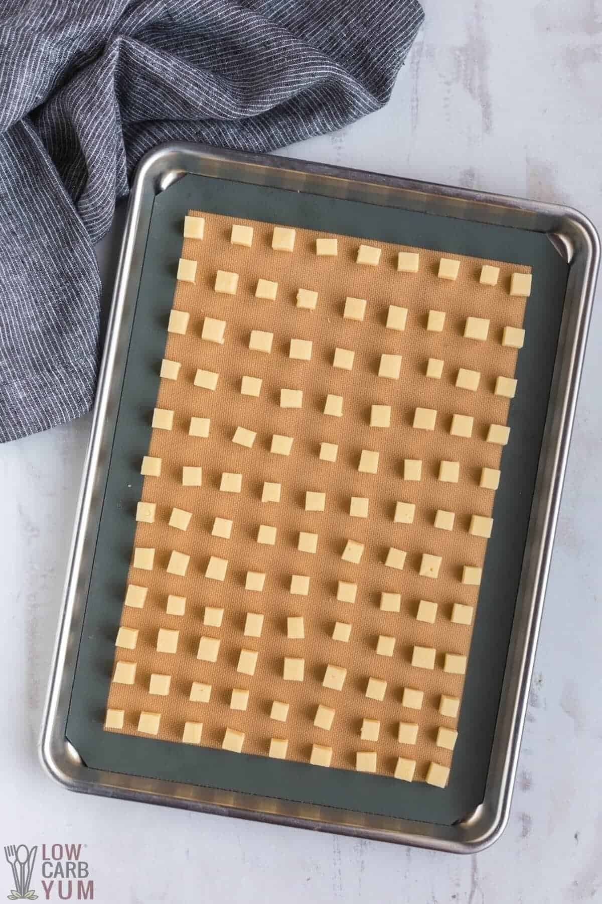 cubed cheese on lined baking sheet pan
