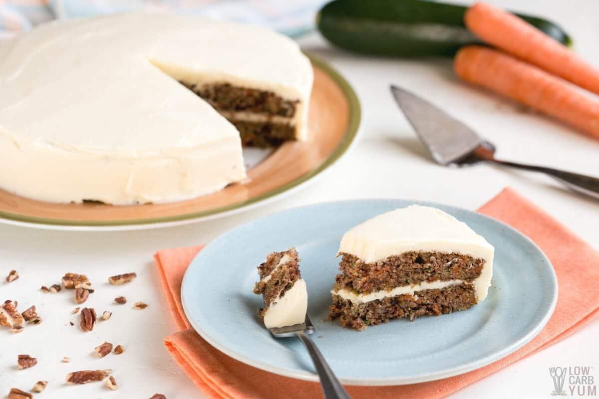 fork bite of carrot cake slice on plate