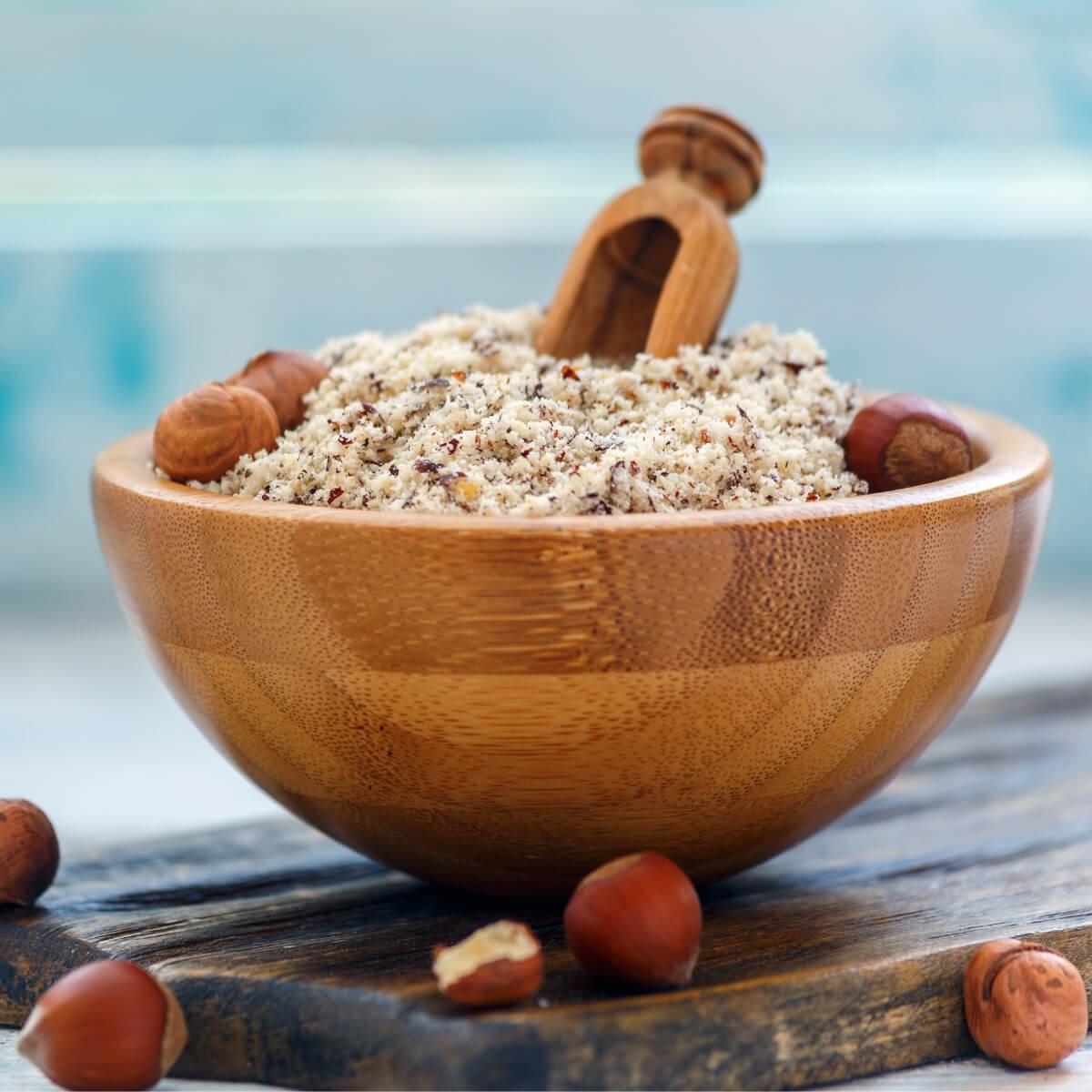 hazelnut flour in wood bowl
