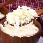 cauliflower rice in wood bowls and spoon