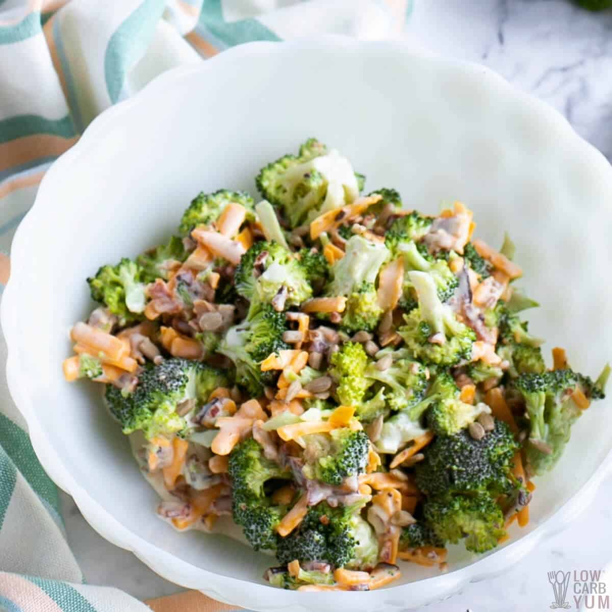 keto broccoli salad with bacon and cheese in white bowl