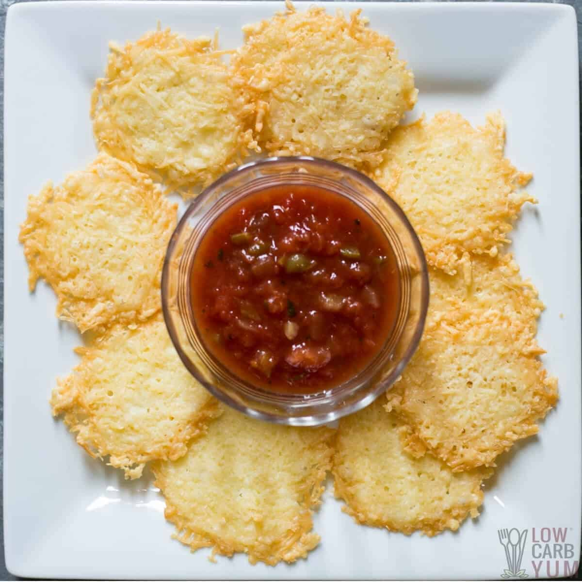 parmesan cheese crisps on plate with salsa