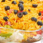 taco dip with meat in casserole pan
