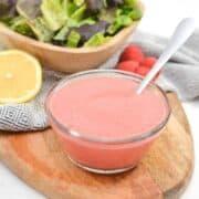 keto raspberry vinaigrette dressing in small glass bowl